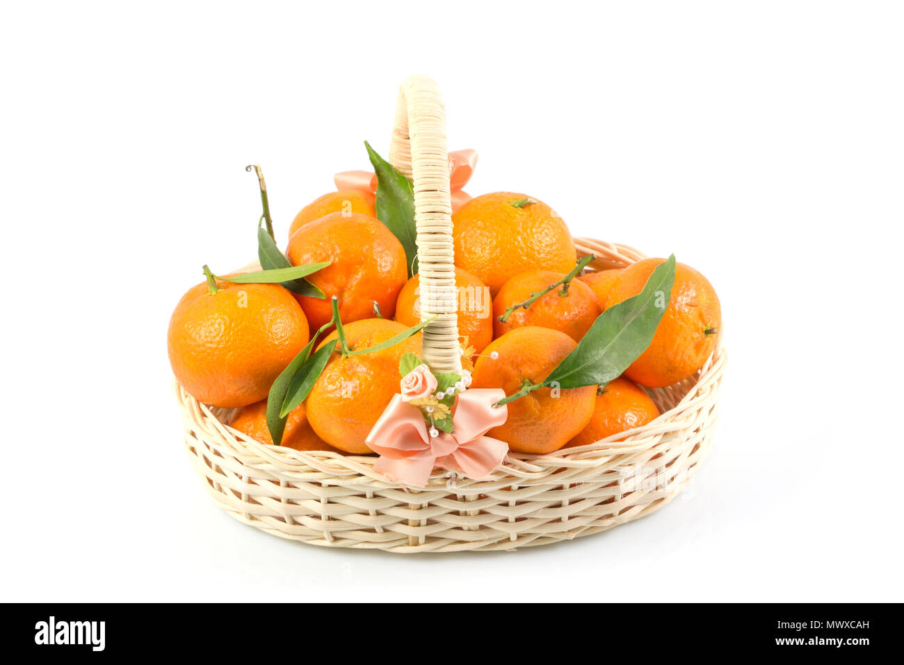 Bunch of fresh tangerines oranges on basket, Fresh orange in rattan baskets gift for Chinese New Year in concept isolated white background. - Stock Image