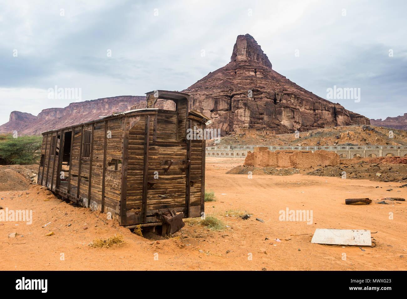 Old wagon in the sand, Hijaz railway station, Al Ula, Saudi Arabia, Middle East - Stock Image