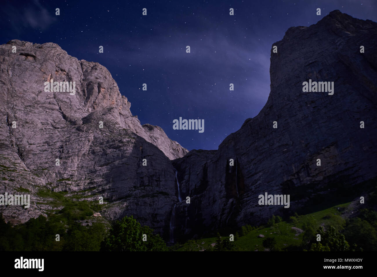 Starry sky above the mountain peaks - Stock Image