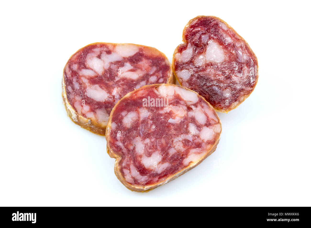 Top view macro detail of smoked salami slices, pepperoni slice, Italian prosciutto crudo ,raw ham texture isolated on white background , with clipping - Stock Image