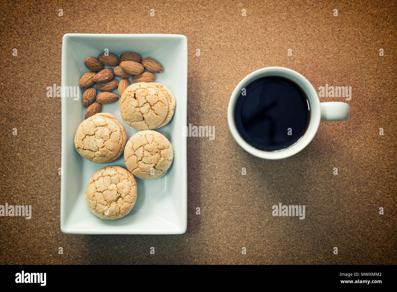 Almond Cookies And A Cup Of Coffee Stock Photo