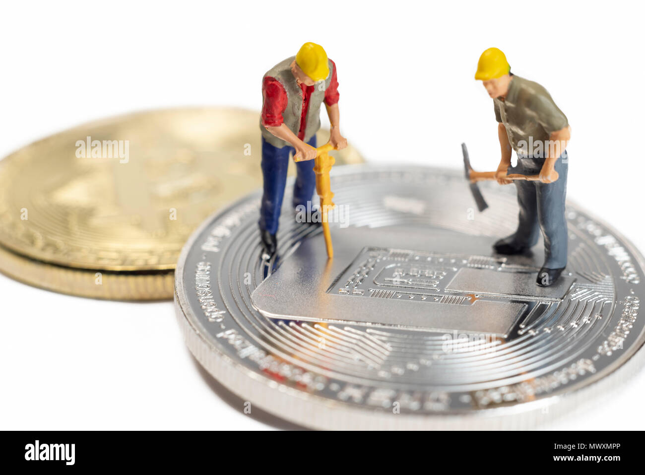 Miniature Workers Mining Dash Cryptocoin On A White Surface Stock