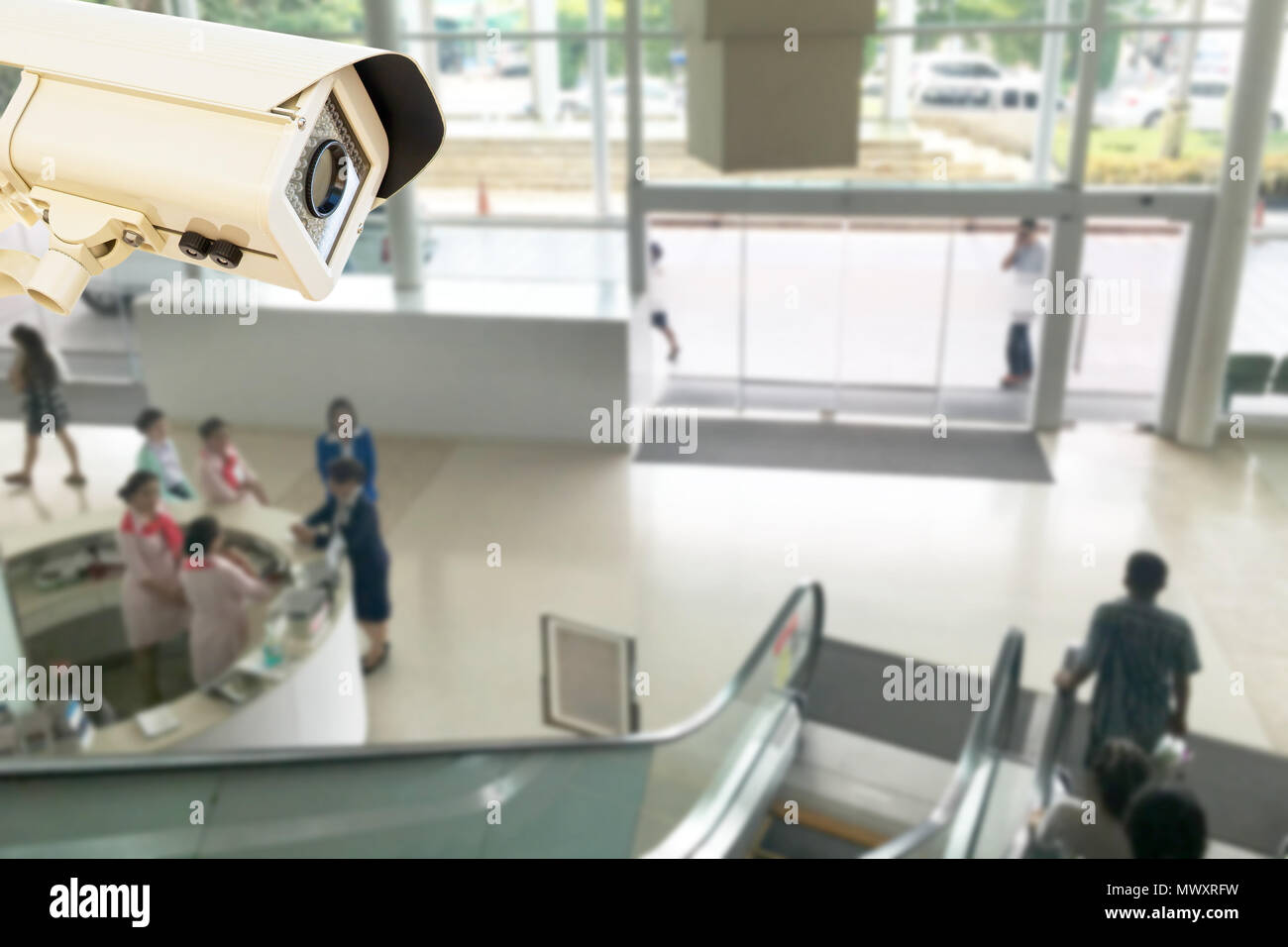 The CCTV Security Camera operating in center public relations hospital blur background. Stock Photo