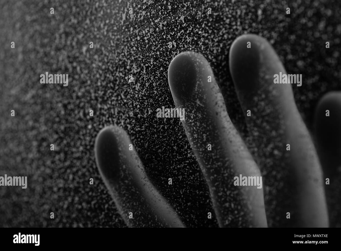 close-up partial view of human hand touching frosted glass - Stock Image