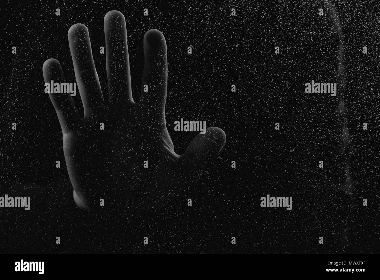 close-up partial view of human hand touching glass with glitches - Stock Image