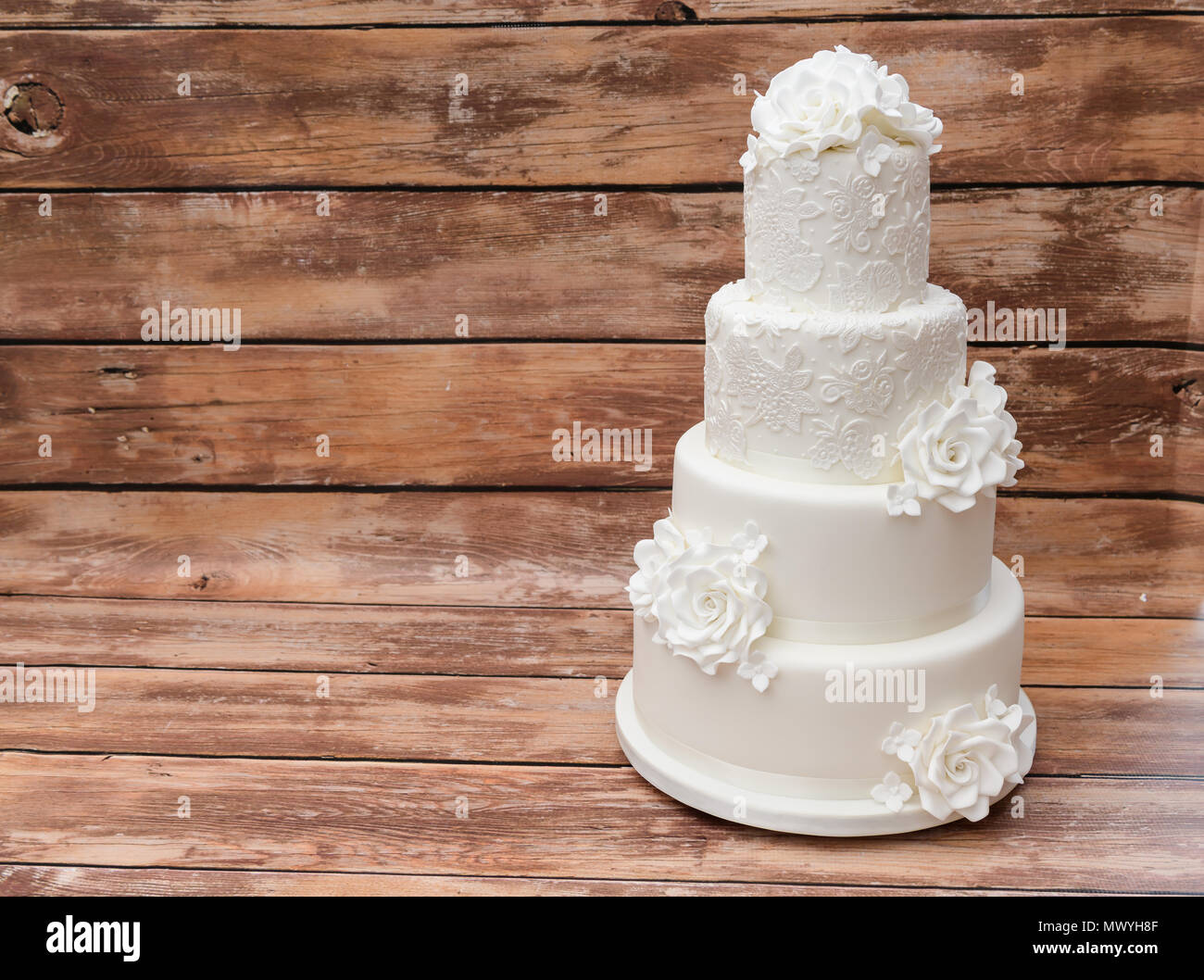 Four tier white wedding cake - Stock Image