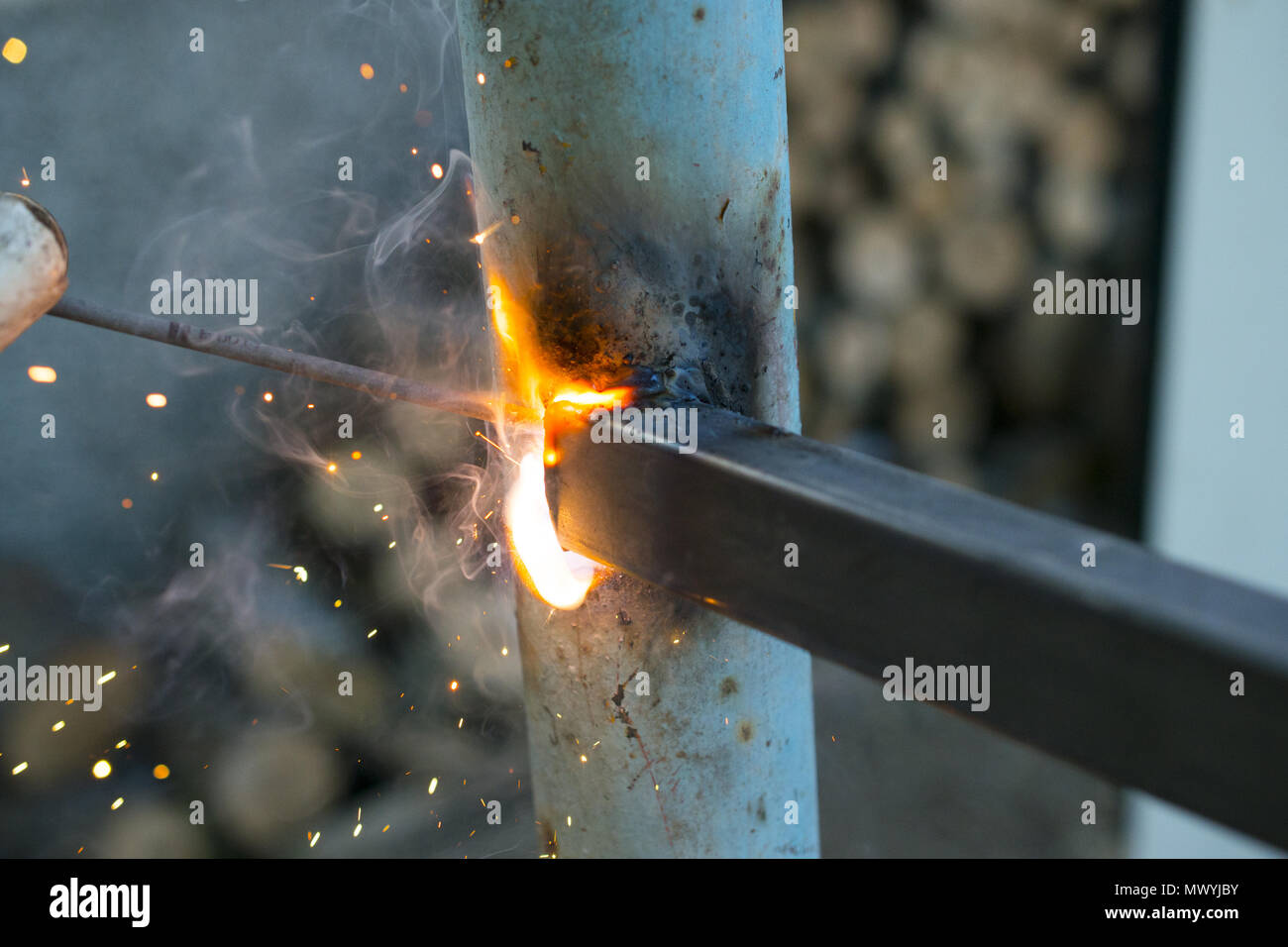 worker welding metal elements on site,image of a - Stock Image
