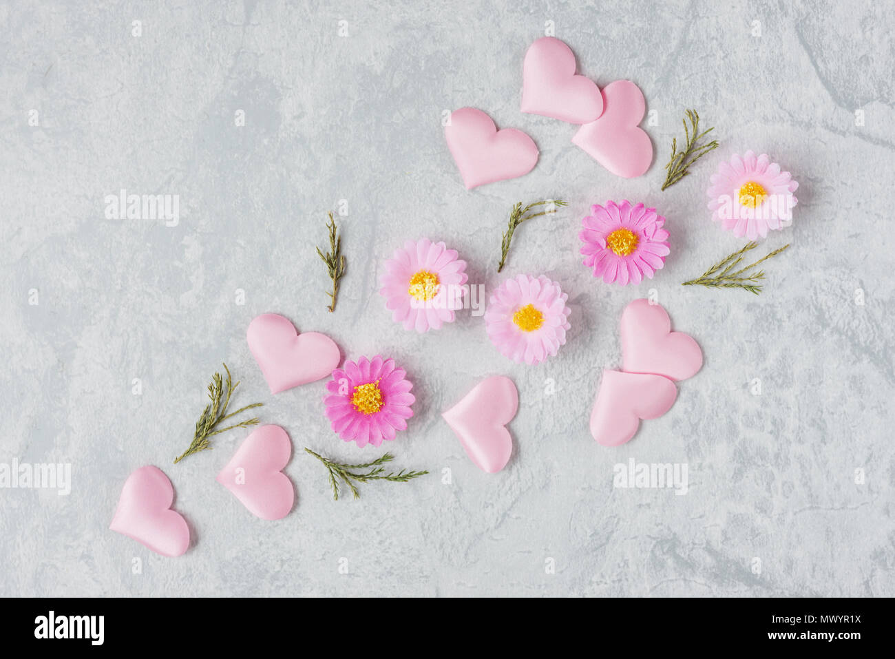 Spring Gentle Romantic Composition With Flowers And Pink Silk Hearts