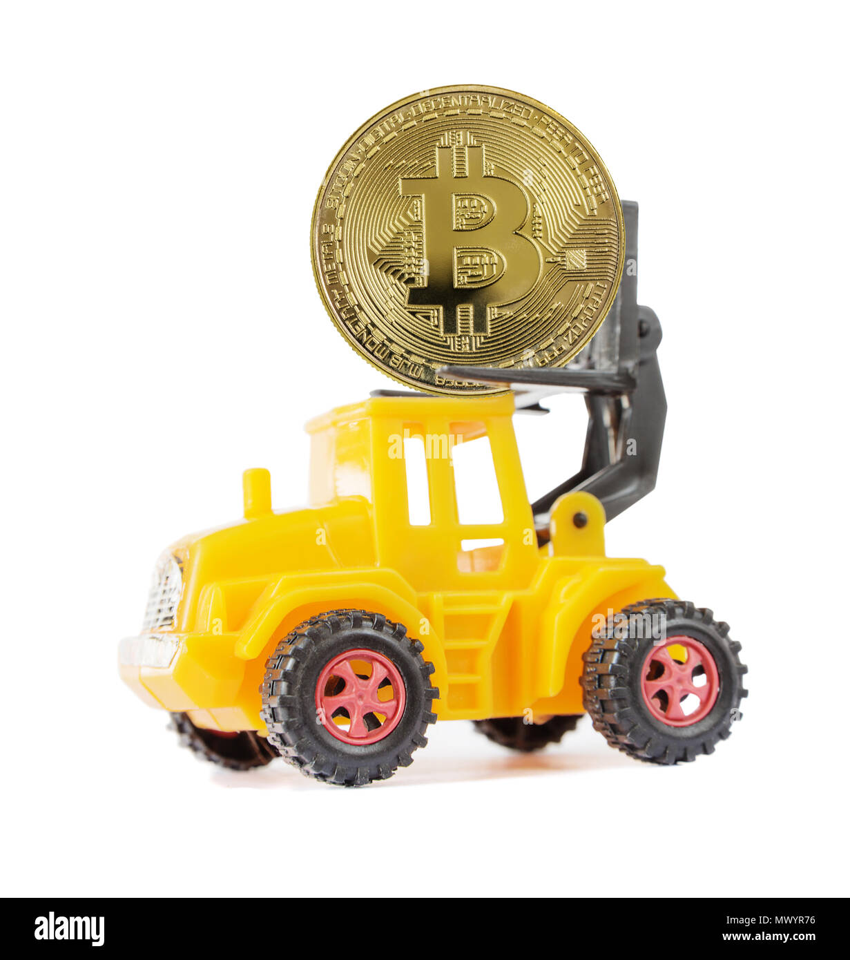Yellow toy forklift transports a symbolic coin of bitcoin crypto currency, new digital money in cyber world, isolated on a white background, side view Stock Photo
