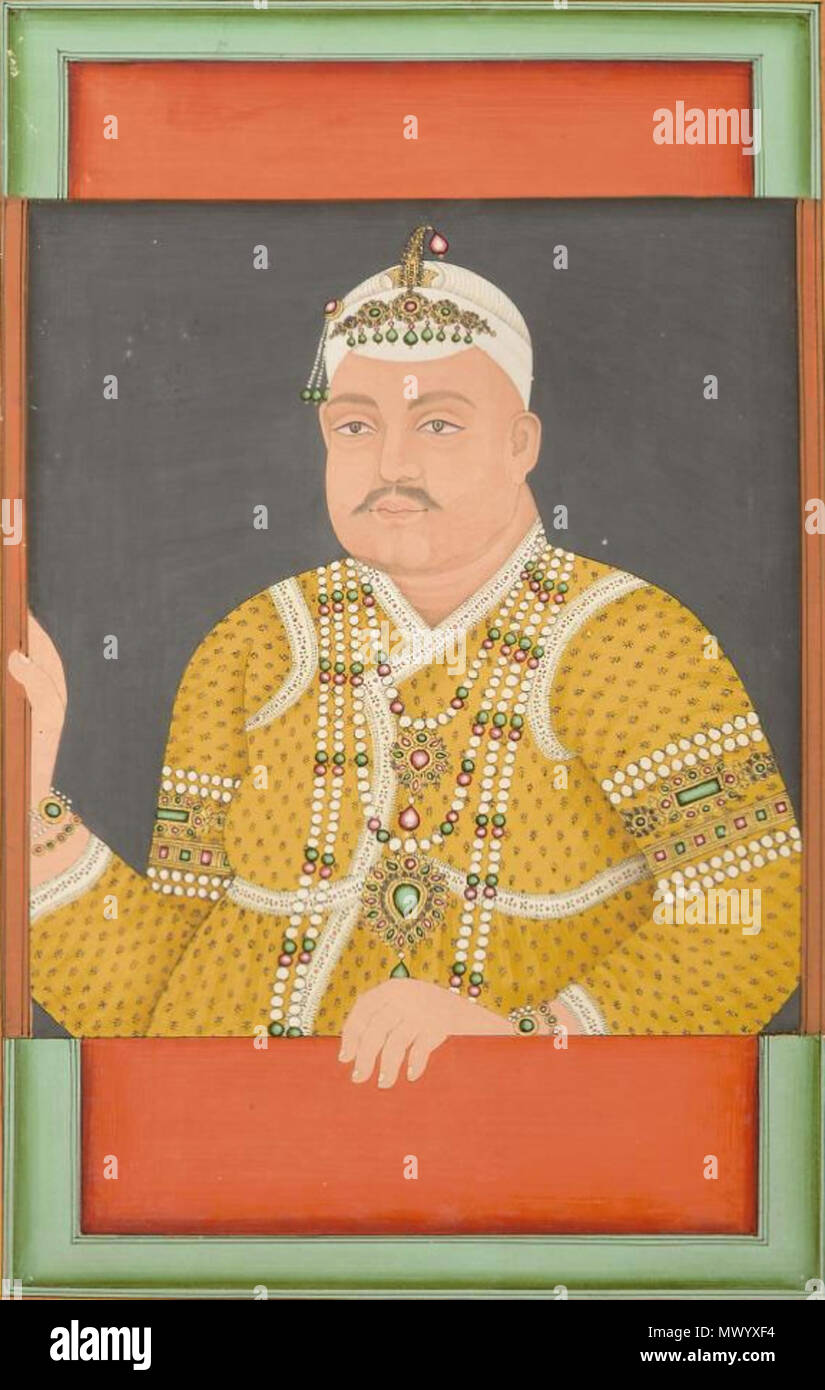 . English: Nasir-ud-dawlah, Nizam of Hyderabad 1794-1857 Gouache on paper heightened with gold, wearing yellow patterened robes and elaborate pearl, emerald and ruby jewelry and white cloth hat, in white mount - 25.4 x 16.5cm  . 19th century. Unknown 439 Nasir-ud-dawlah, Nizam of Hyderabad 1794-1857 - Stock Image