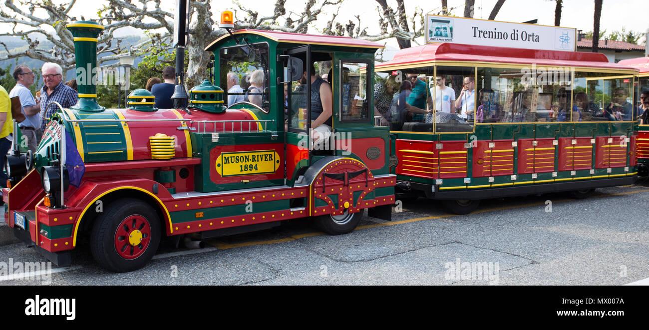 Tourist small train in Orta San Giulio, Pidmont, Italy - Stock Image