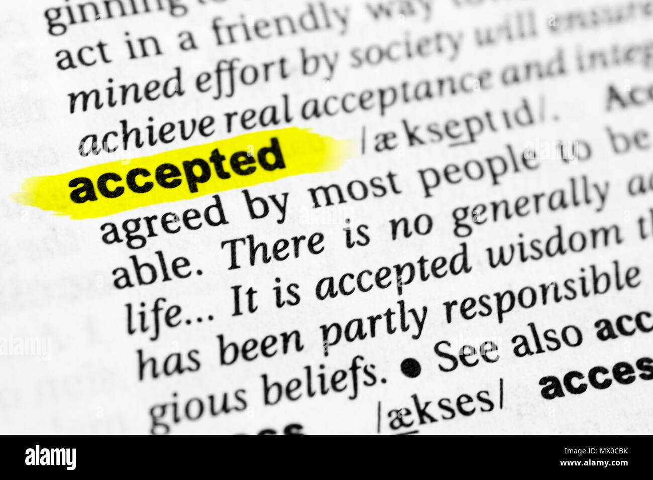 Highlighted English word 'accepted' and its definition in the dictionary. - Stock Image