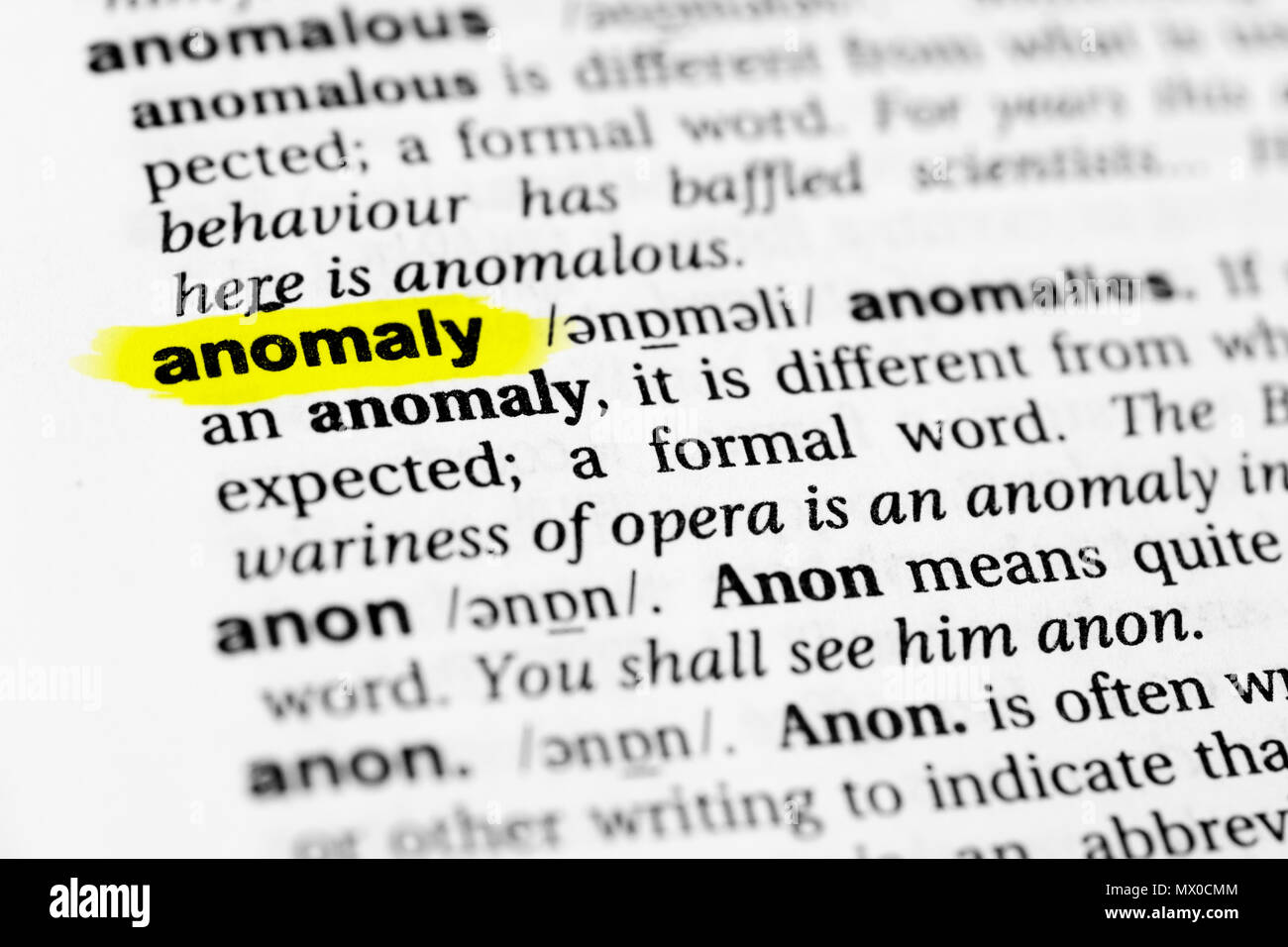 Highlighted English word 'anomaly' and its definition in the dictionary. - Stock Image