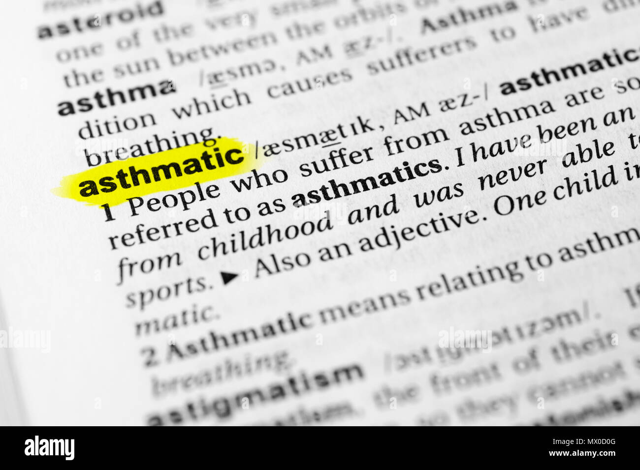 Highlighted English word 'asthmatic' and its definition in the dictionary. - Stock Image