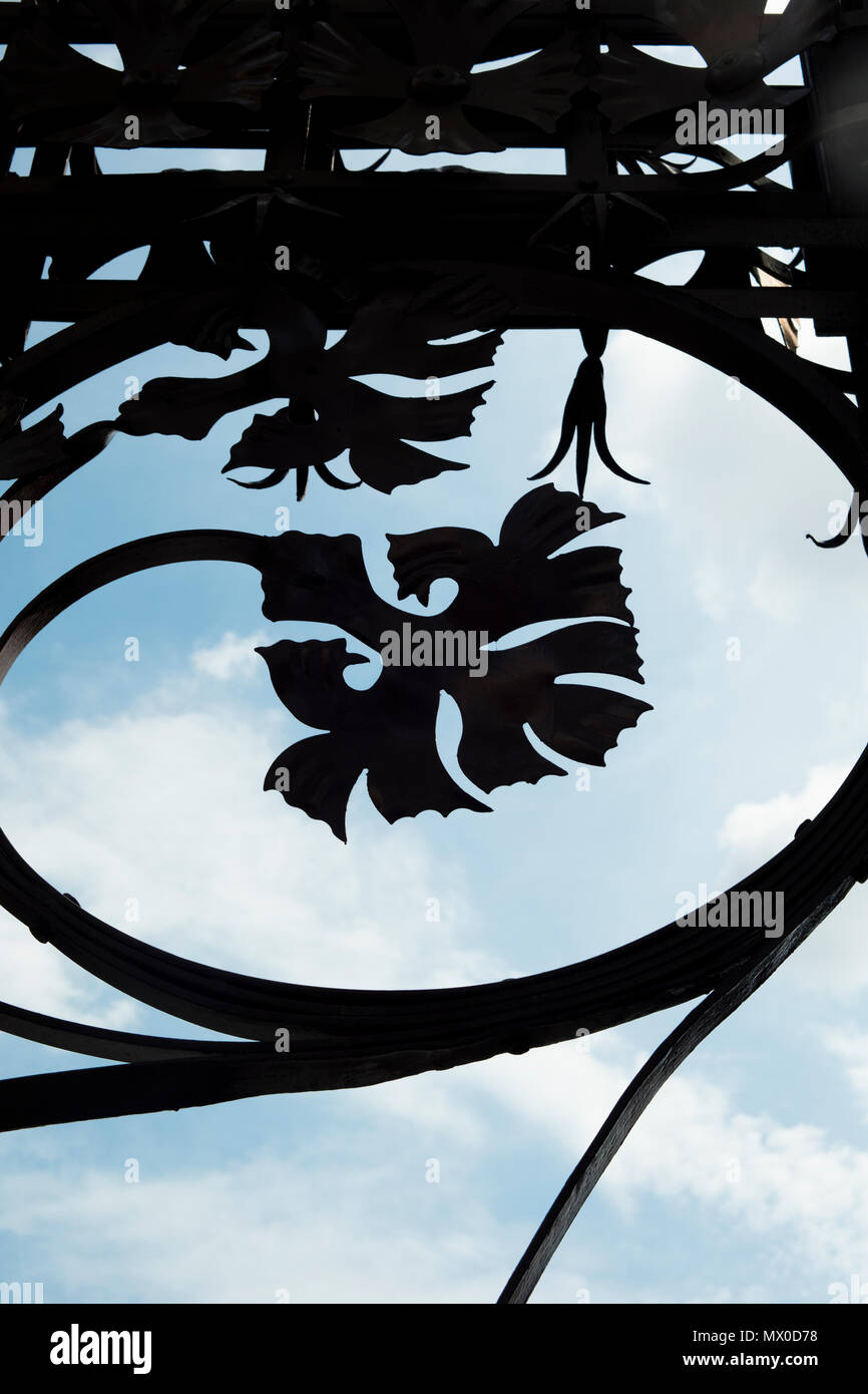 Detail of street lamp iron ornaments in Barcelona, imitating organic elements such as leafs. - Stock Image