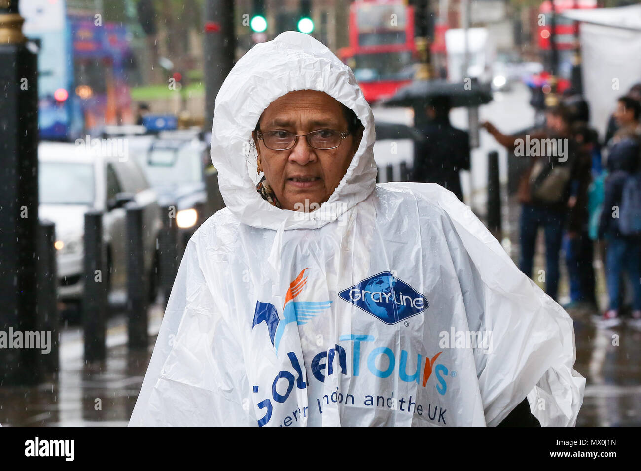 Tourists in Westminster wearing rain ponchos as rain falls in the capital.  Featuring: Atmosphere, View Where: London, United Kingdom When: 02 May 2018 Credit: Dinendra Haria/WENN - Stock Image