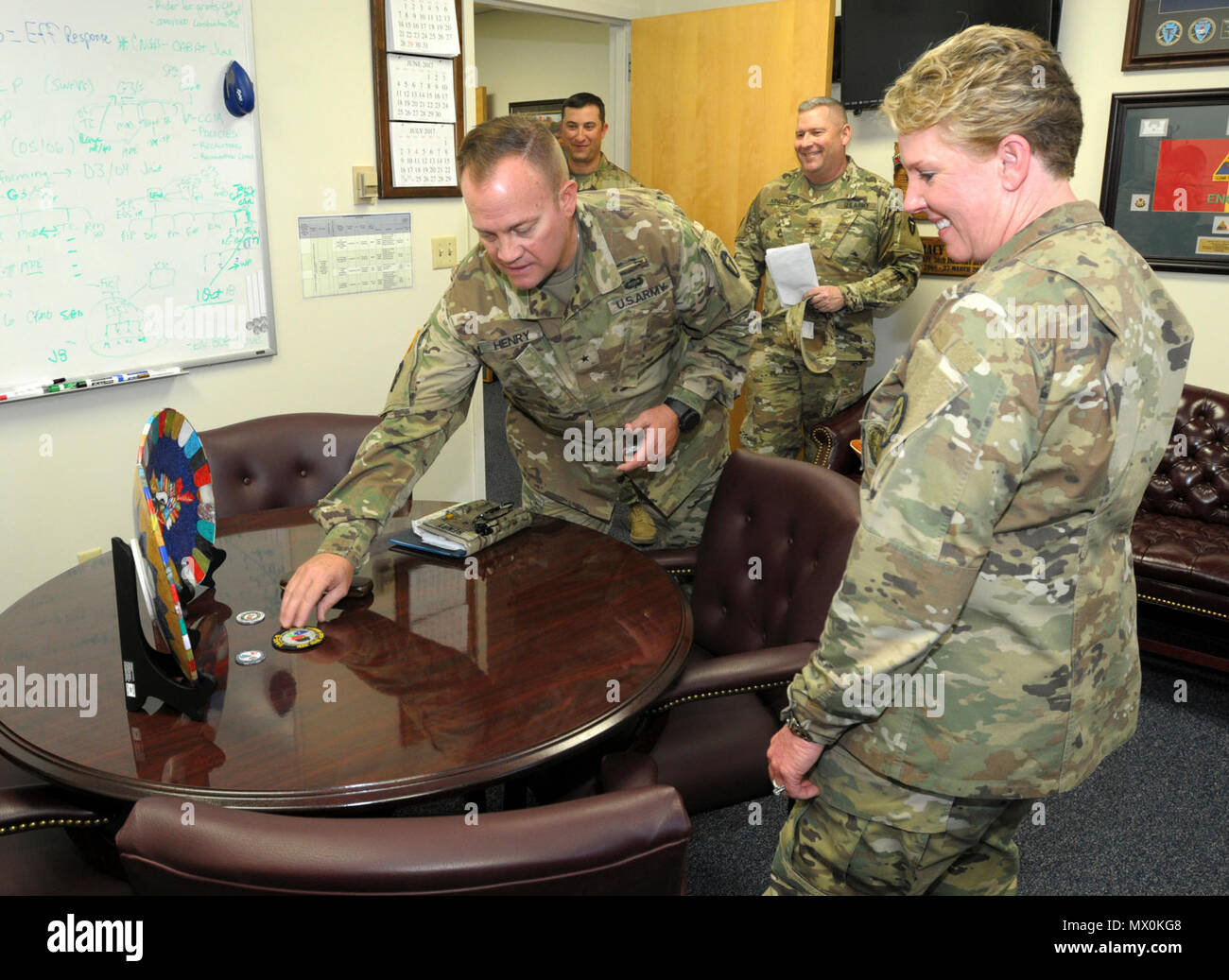 Lee Henry, 36th Infantry Division Train Advise and Assist-South Commander, presents Bring Gen. Tracy Norris, Texas Army National Guard Commander, with gifts ...