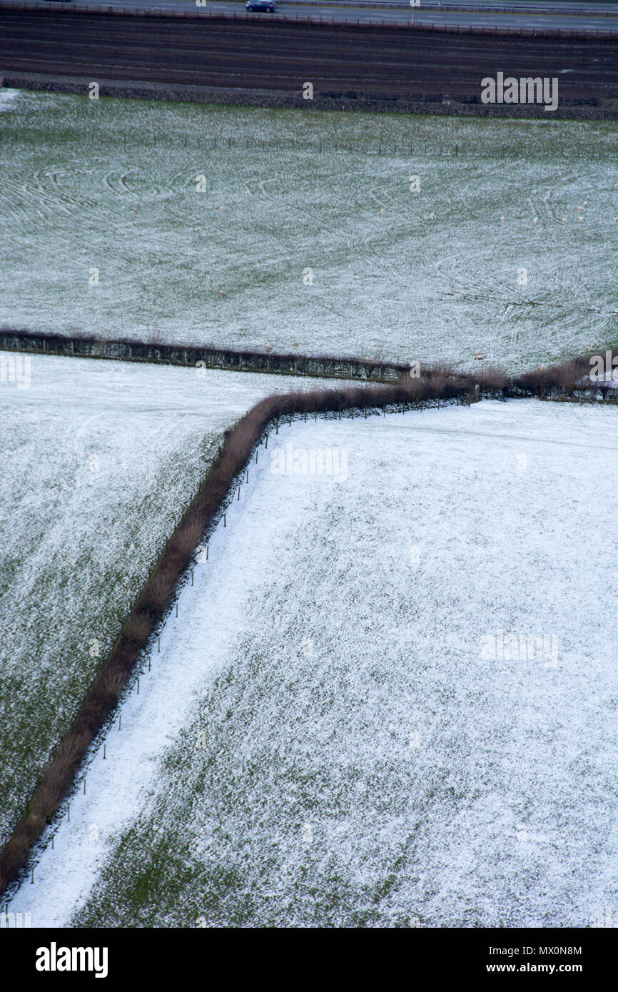 View of snow clad fields from Farleton Knott, Lancashire, England, UK - Stock Image