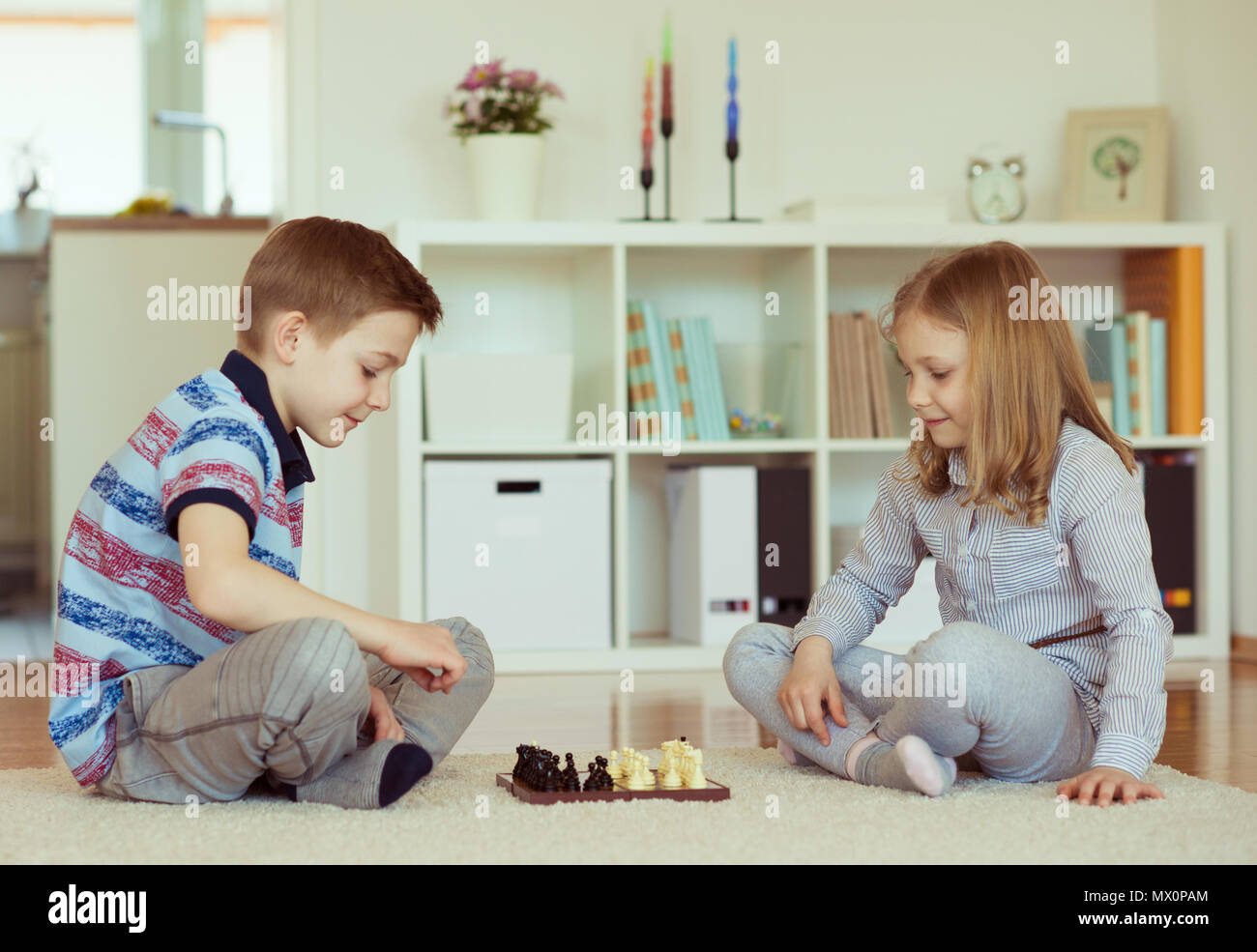 two little children playing chess at home emotionally stock photo rh alamy com chase at home jobs chest at home exercise