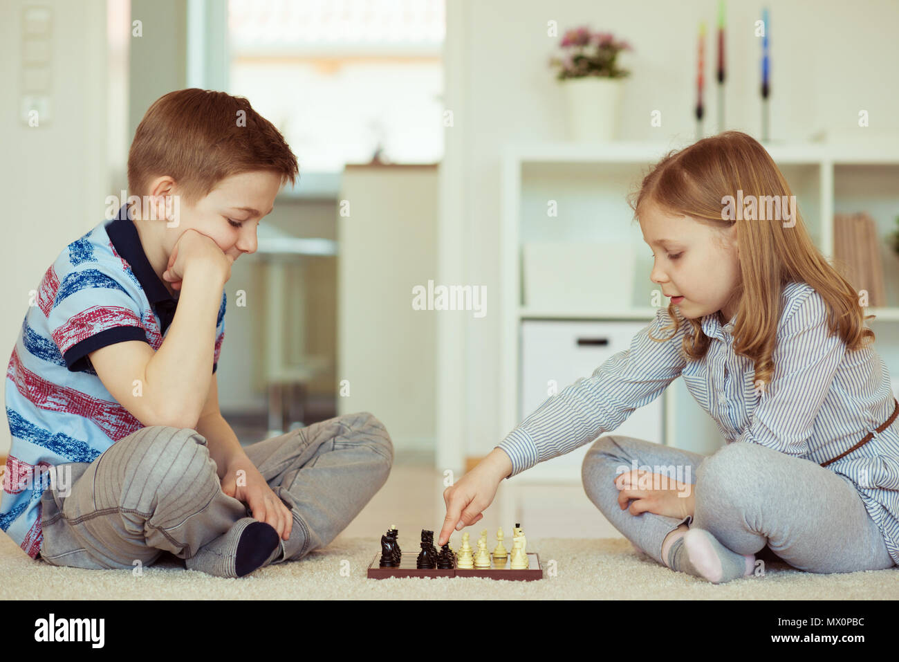 portrait of two little children concentrated playing chess at home rh alamy com chase at home chase at home