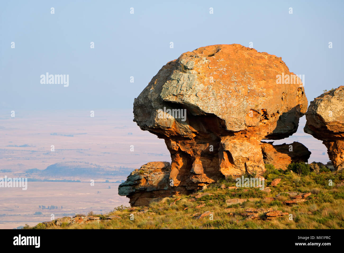 Sandstone rock formation against a distant hazy sky, South Africa Stock Photo