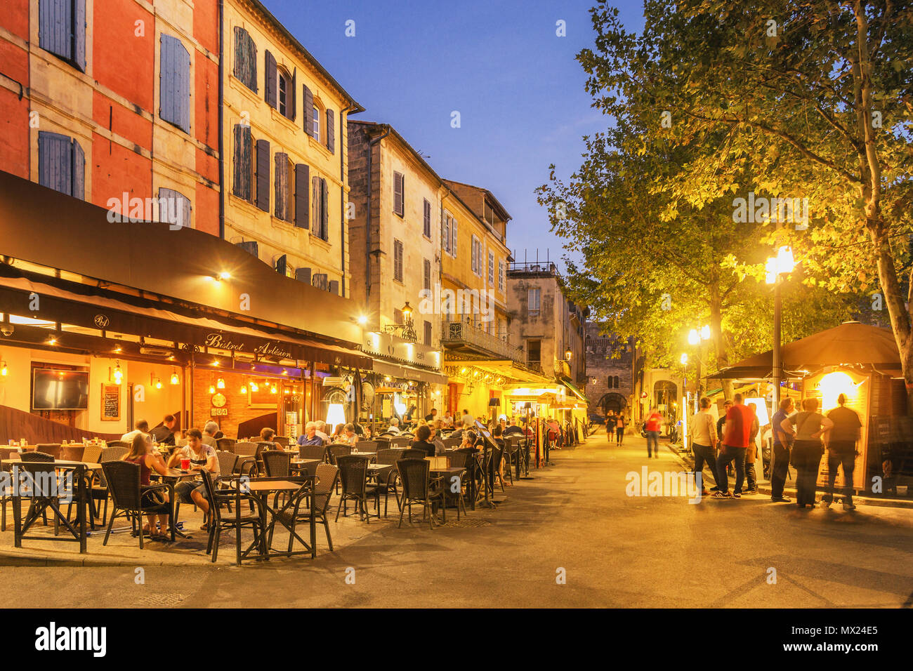 Arles, France - September 4, 2017: Locals and tourists spending time at the Place du Forum with its Cafés and Bistros. - Stock Image