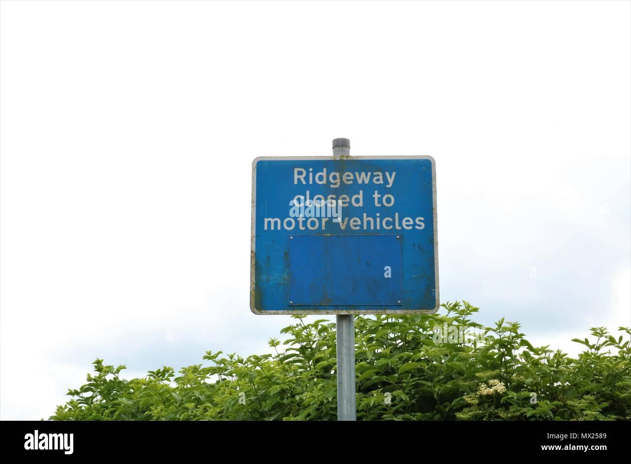'Ridgeway closed to motor vehicles' blue sign at White Horse Hill, Uffington, Faringdon, Oxfordshire, UK - Stock Image