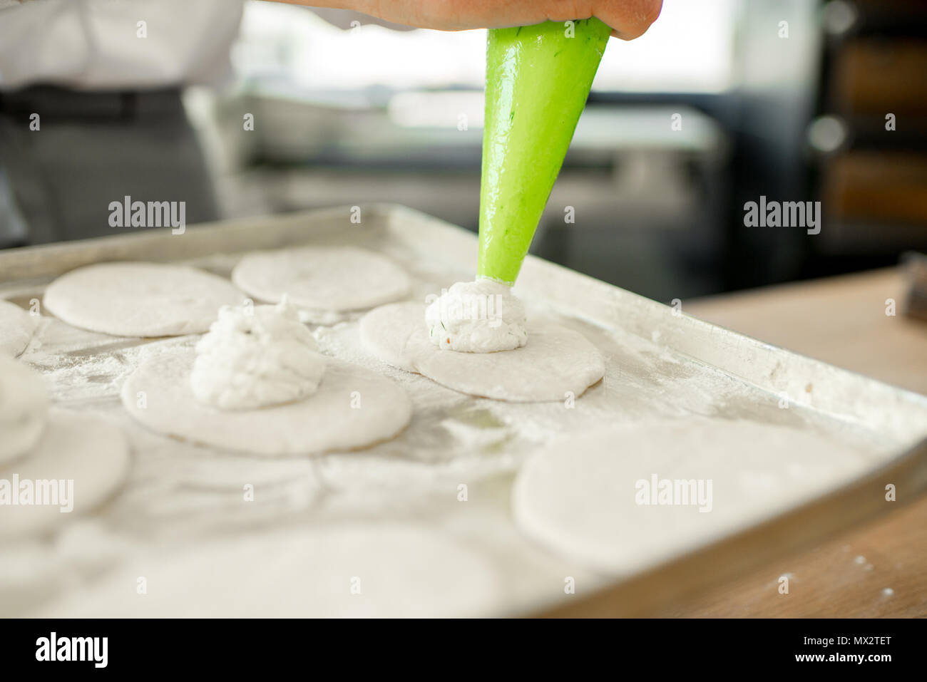 Filling buns at the manufacturing - Stock Image