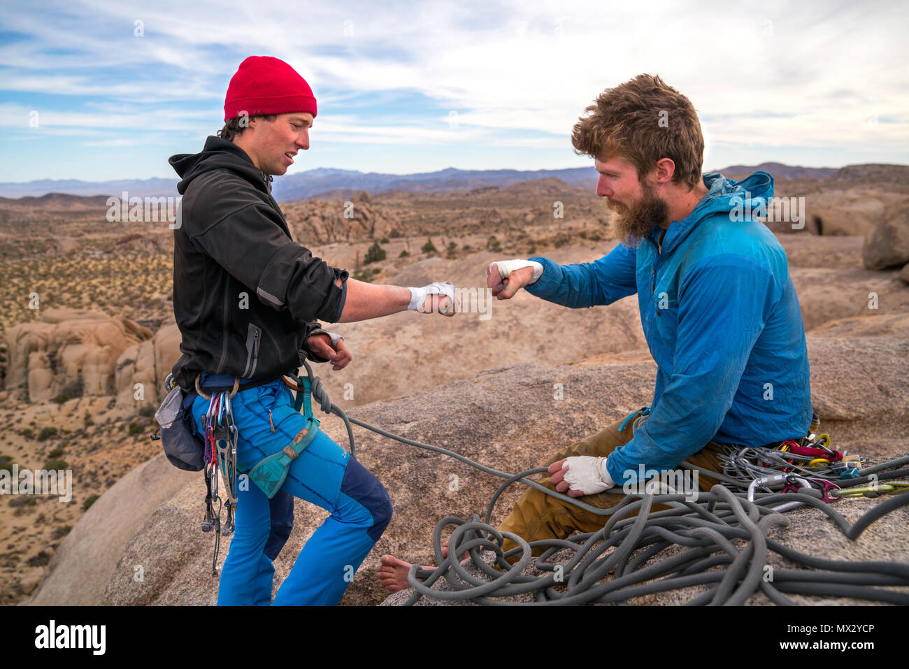 Fist pump after finishing a climb in Joshua Tree National Park. - Stock Image