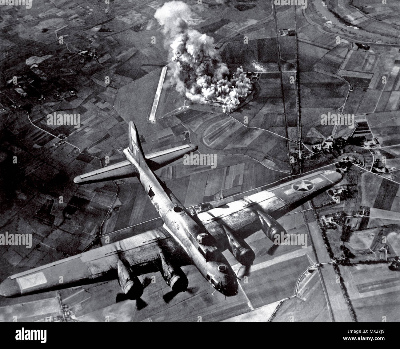 BOMBING B-17 Germany WW2  1940's Bombing Raid by a B-17 Flying Fortress of the American 8th Air Force on a Focke Wulf aircraft manufacturing plant at Marienburg Germany 1943. This notable World War II raid was a total success obliterating the plant completely with pinpoint bombing - Stock Image