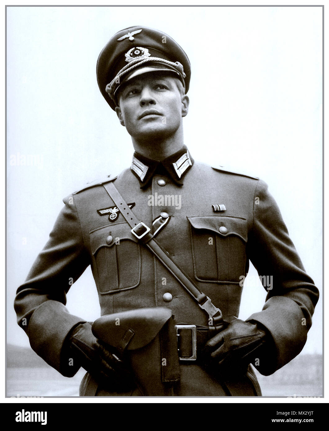 Vintage B&W film still image of Marlon Brando in Nazi military uniform starring in The Young Lions a 1958 Twentieth Century Fox movie film directed by Edward Dmytryk American-Canadian film director Stock Photo
