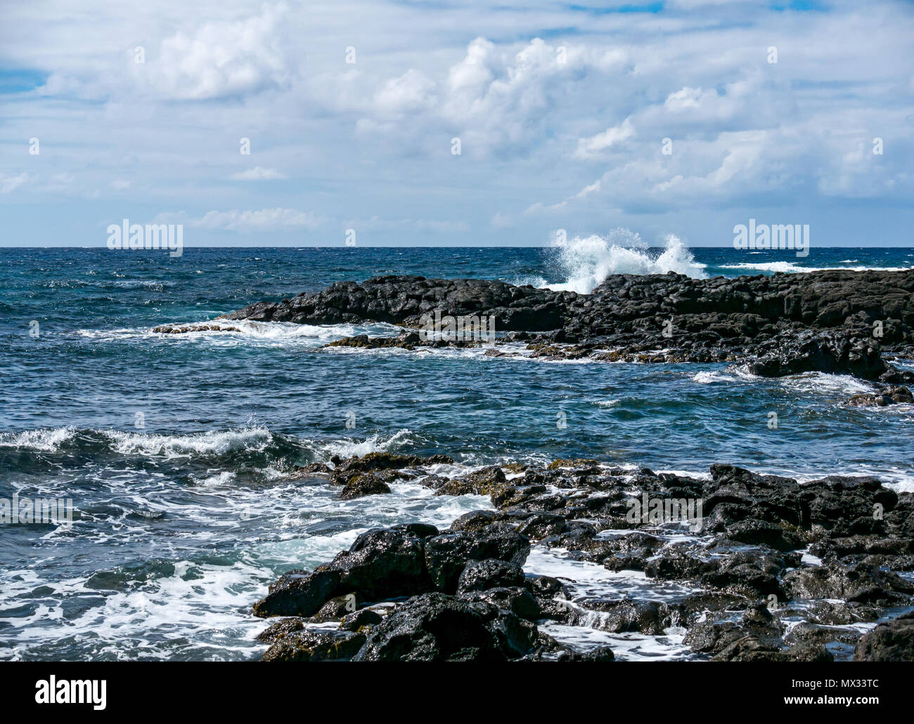 Waves breaking on rocky shore, Easter Island, Rapa Nui, Chile - Stock Image