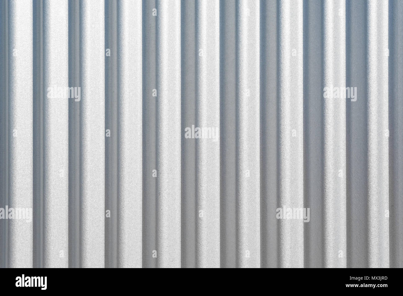 Background texture of clean wavy corrugated vertical metal
