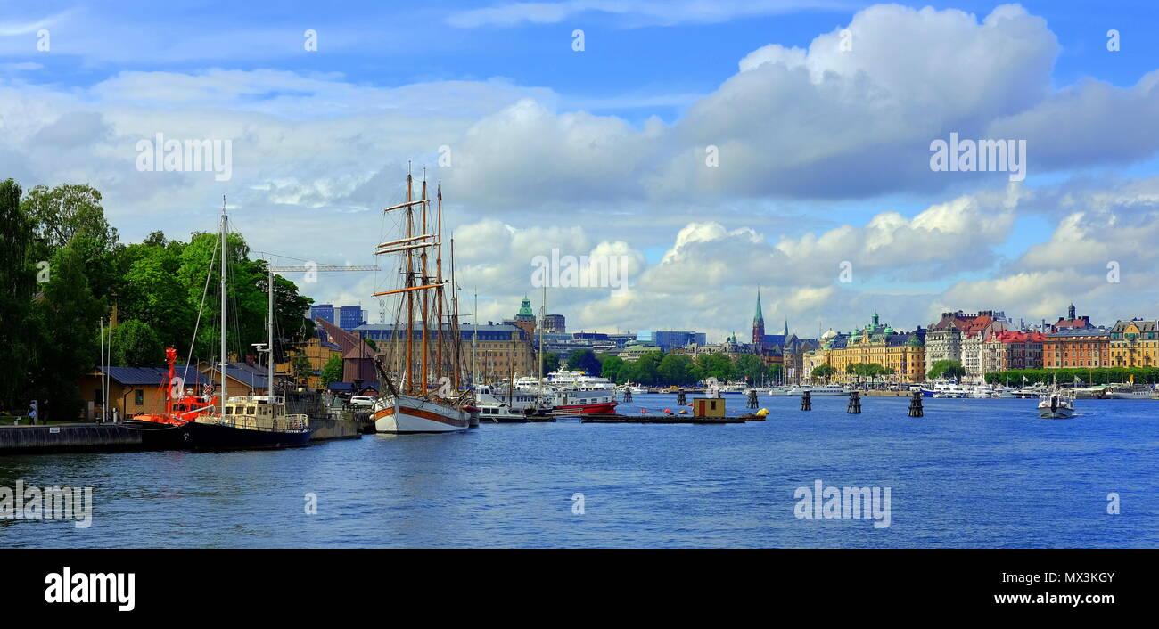 Stockholm Harbour Skeppsholmen Sailing boats, and historic buildings. - Stock Image