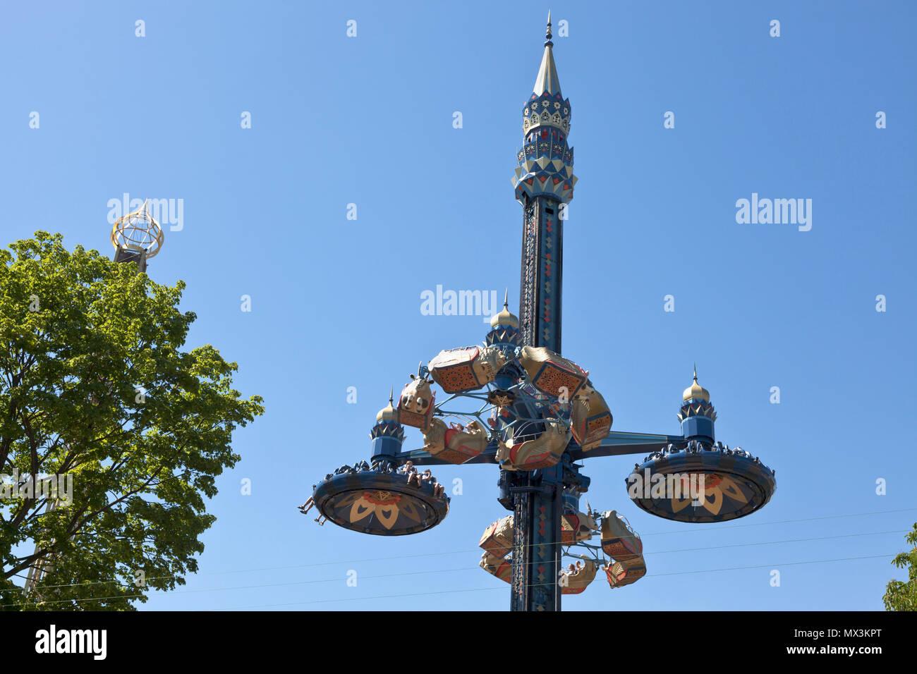 The Fatamorgana ride in the Tivoli Gardens, Copenhagen, Denmark, in early summer. Blue sky. Stock Photo