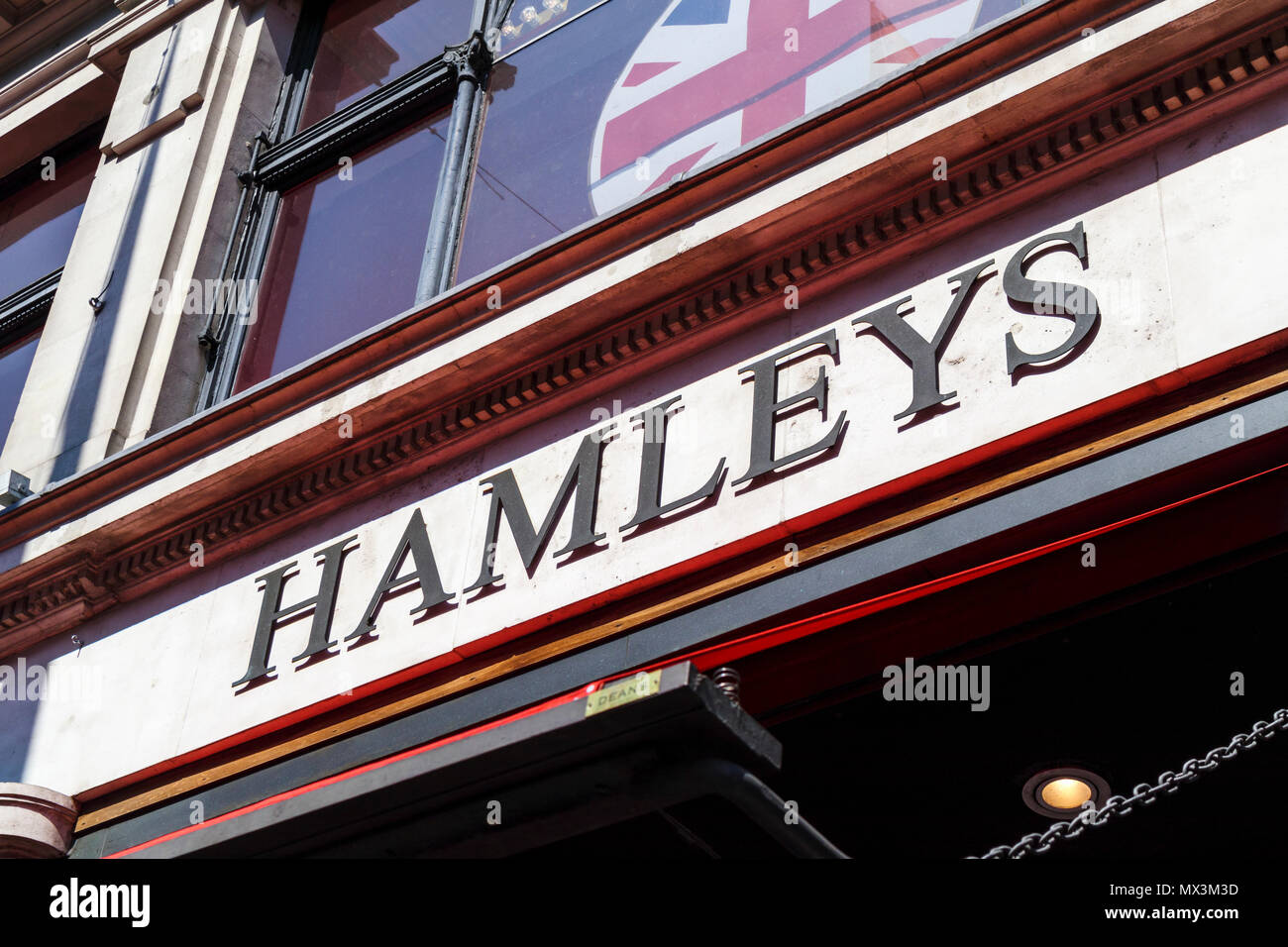 Name sign outside on the frontage of Hamleys, the iconic toy shop in Regent Street, London W1 a major shopping street in the capital city, UK - Stock Image