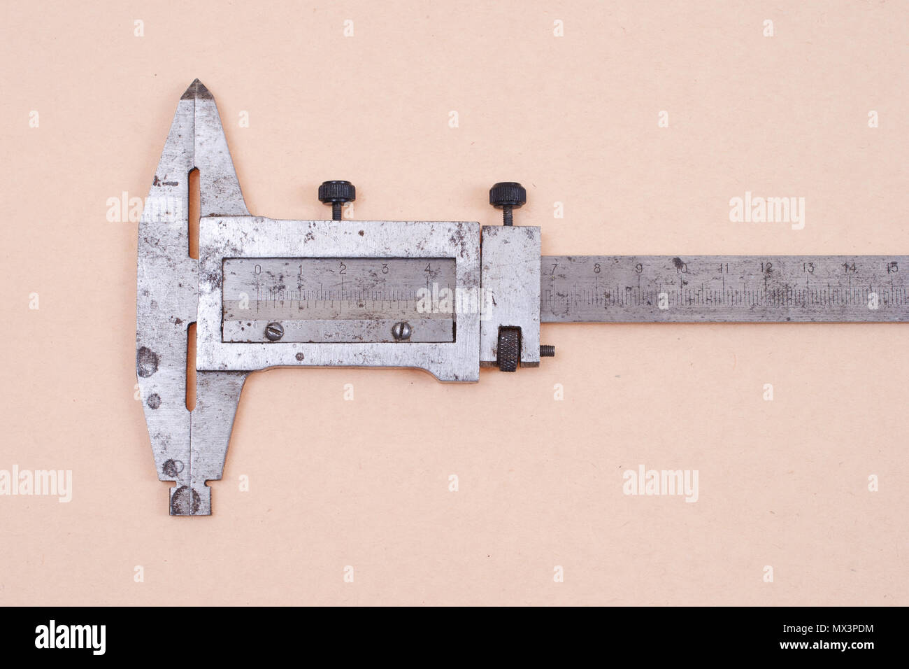 Vernier calipers isolated on old paper background - Stock Image