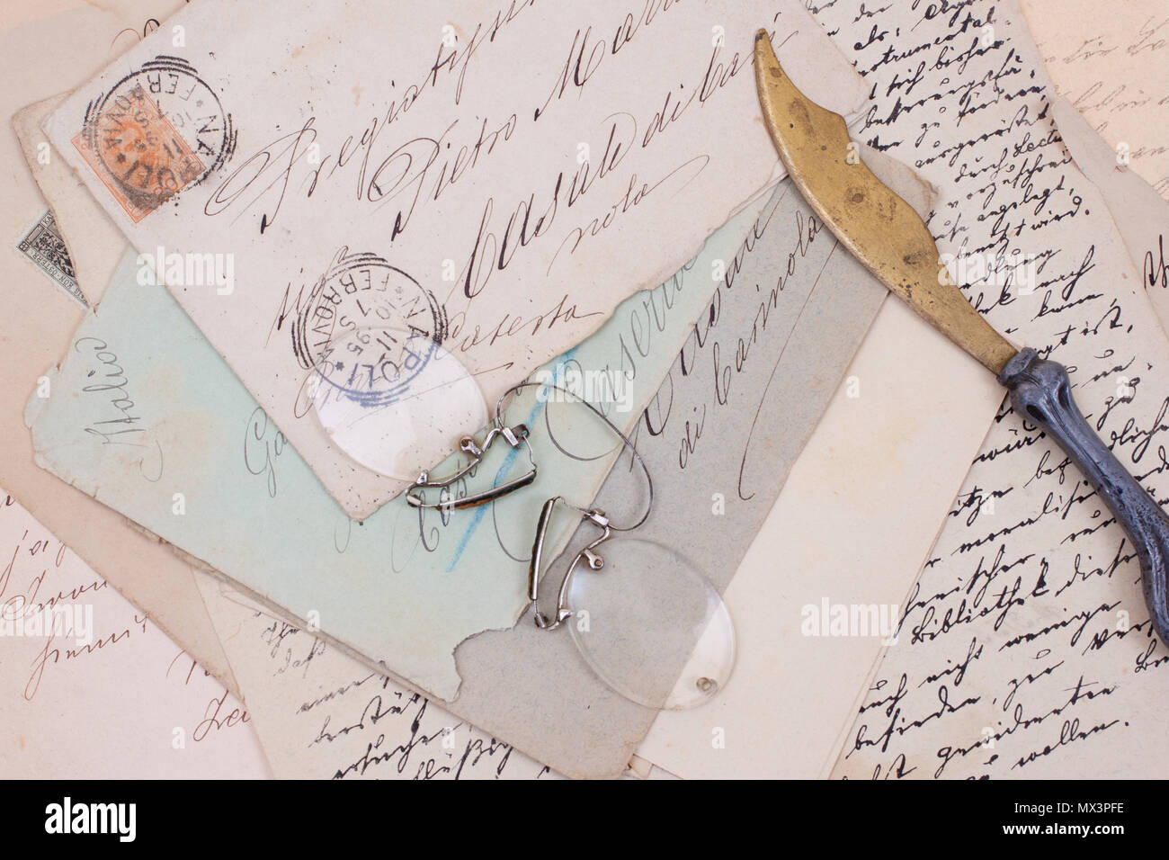 background with old vintage letters and vintage letter opener - Stock Image
