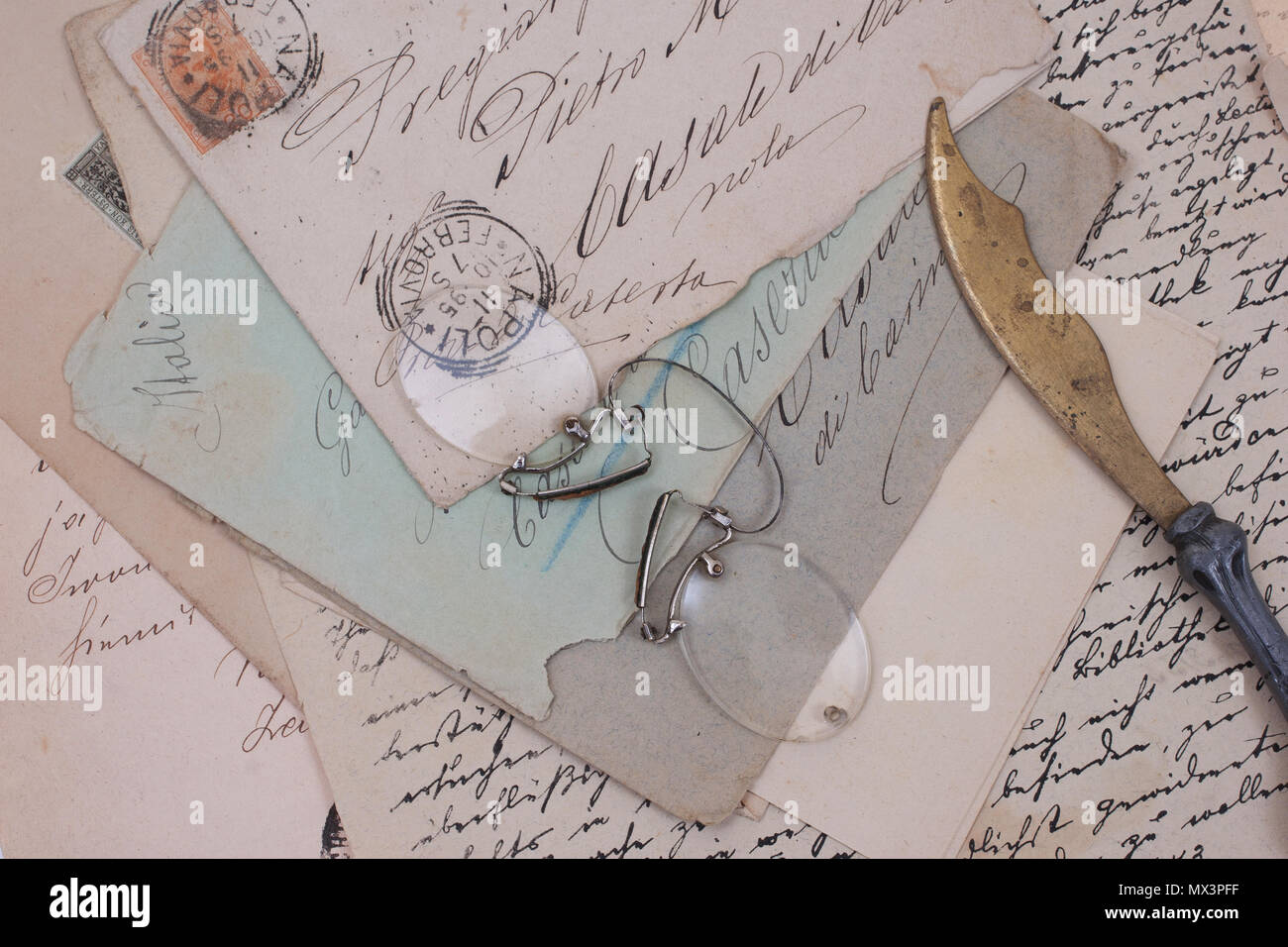 background with old vintage letter and letter opener - Stock Image