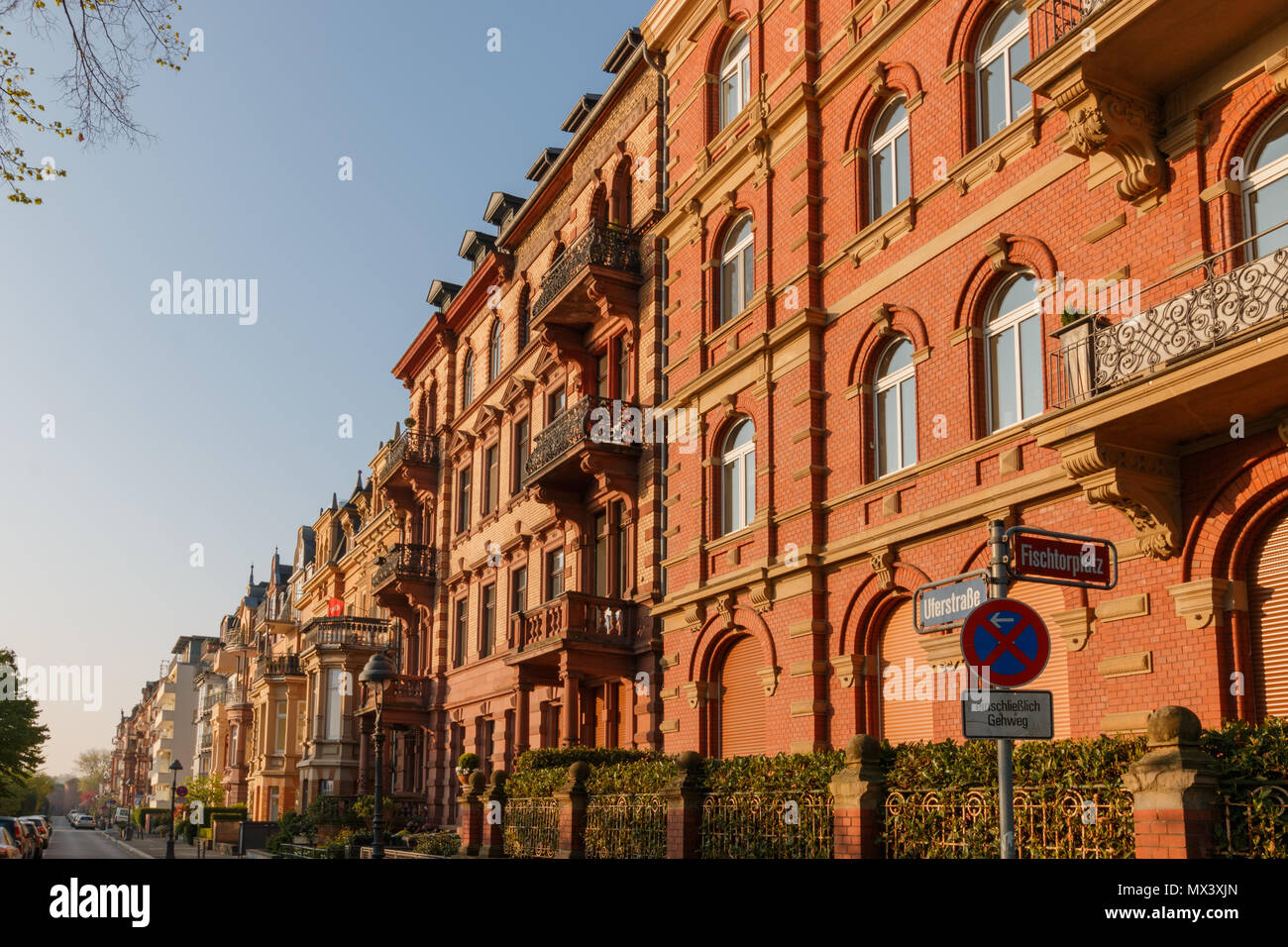 Sun shines on beautiful old houses at Uferstrasse in Mainz early in the morning Stock Photo
