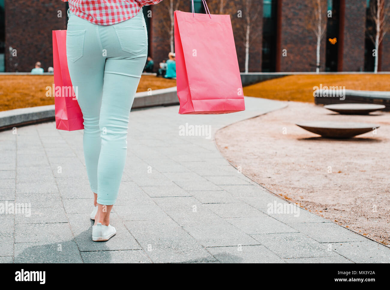 Colorful shopping bags. Pink, yellow bags full of shopping. Concept lifestyle and shopping. Satisfaction with bought clothes. - Stock Image