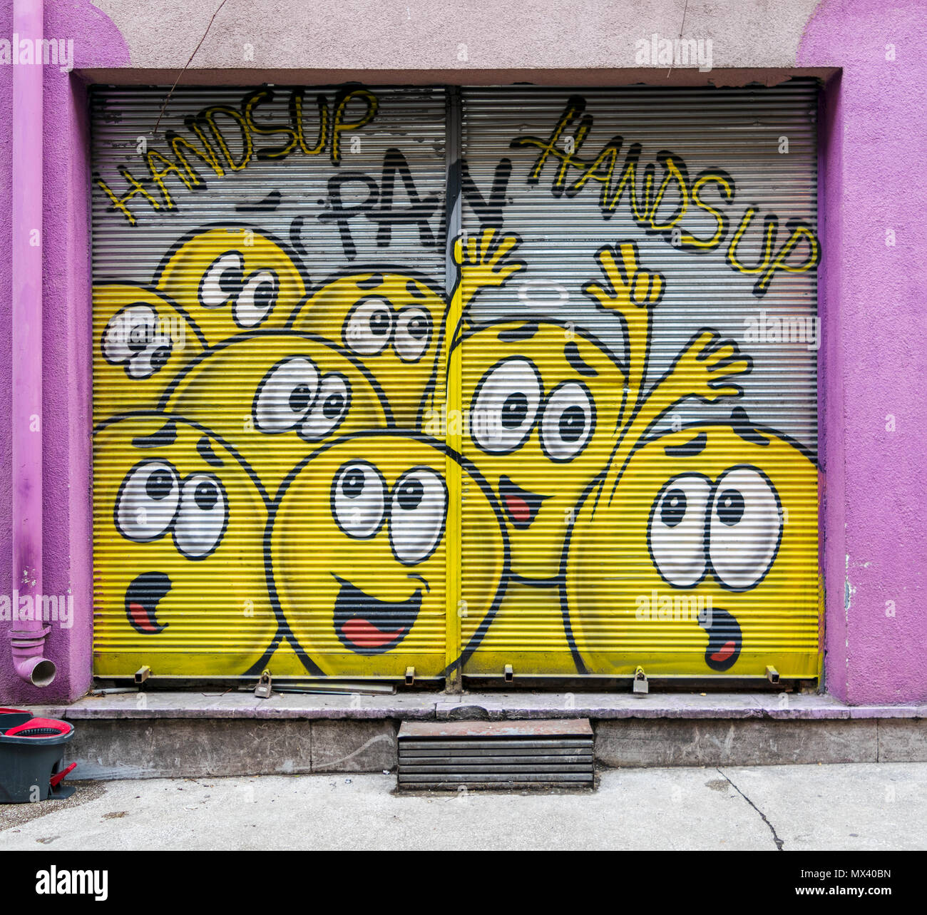 Istanbul, Turkey - April 18, 2017:  Closed shop exterior with metal door covered with colorful graffiti at Karakoy district, Istanbul, Turkey - Stock Image