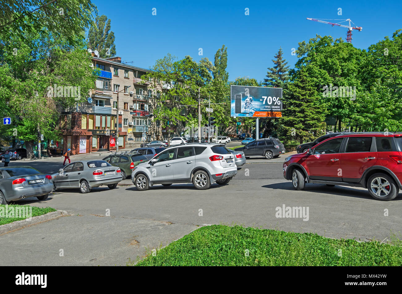 Dnipro, Ukraine - May 17, 2017: Illegal parking on a sidewalk in downtown Dnipro. Violation of parking rules and rights of pedestrians with the full c - Stock Image
