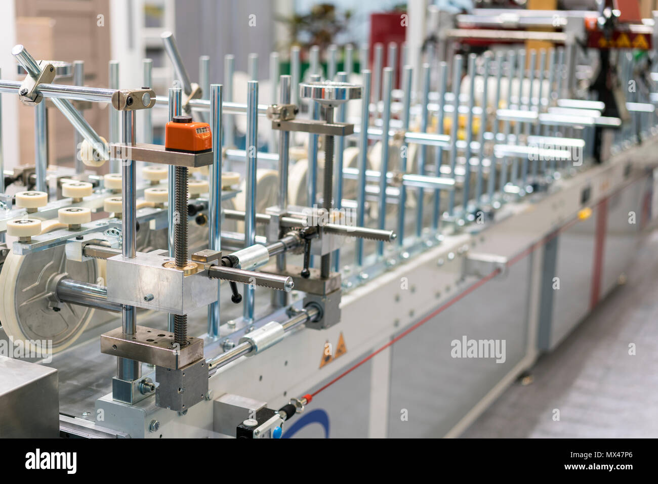 Textile processing machine. Machinery and equipment in a spinning production company. - Stock Image