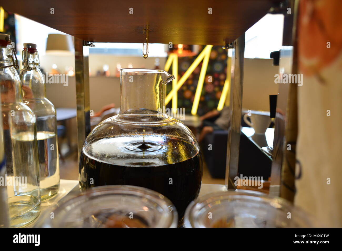 Coffee brewing at the cold brew glass device - Stock Image