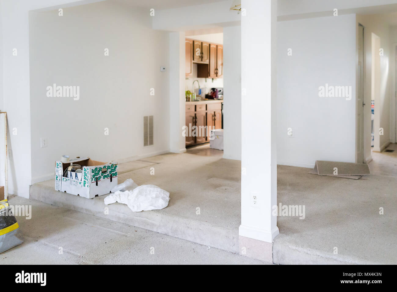 Empty dirty room with boxes and carpet during remodeling, renovation ...