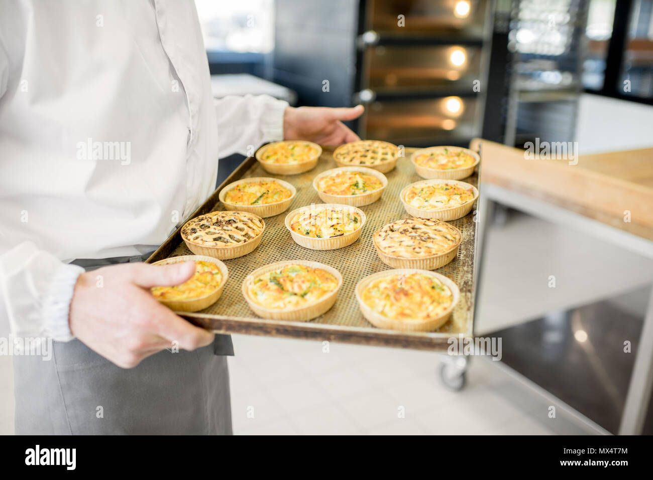 Holding tray with freshly baked buns - Stock Image