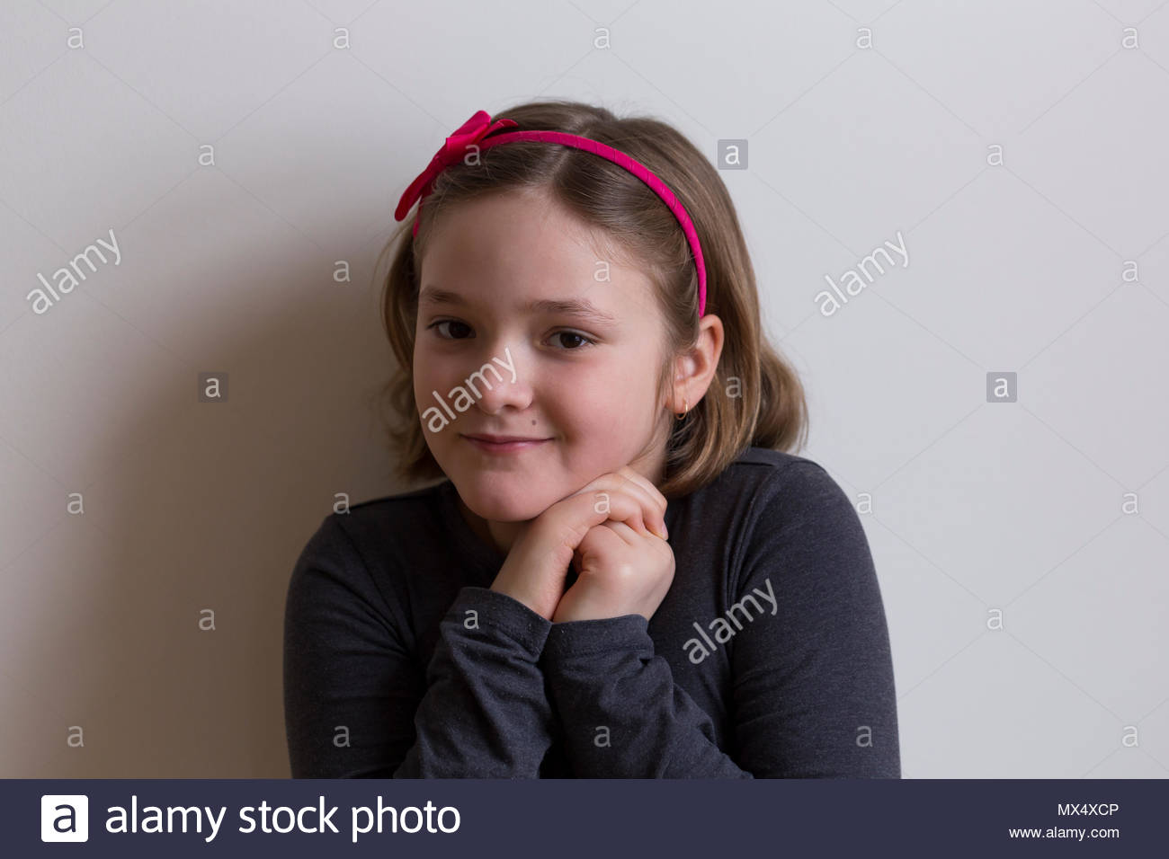 Closeup Of Pretty Smiling Eight Year Old Little Girl With Bob Short