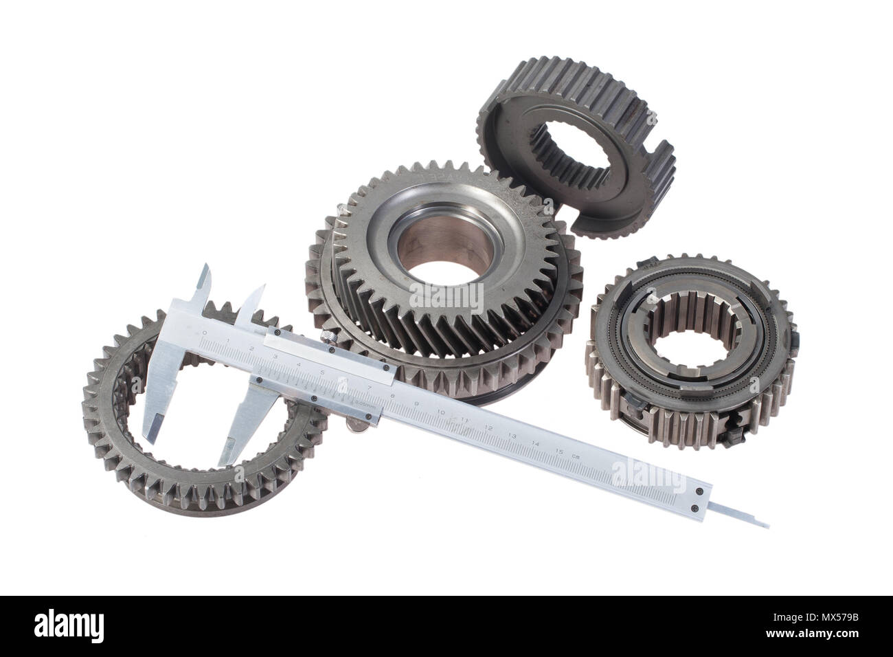 cog wheels with vernier calipers isolated on white background - Stock Image