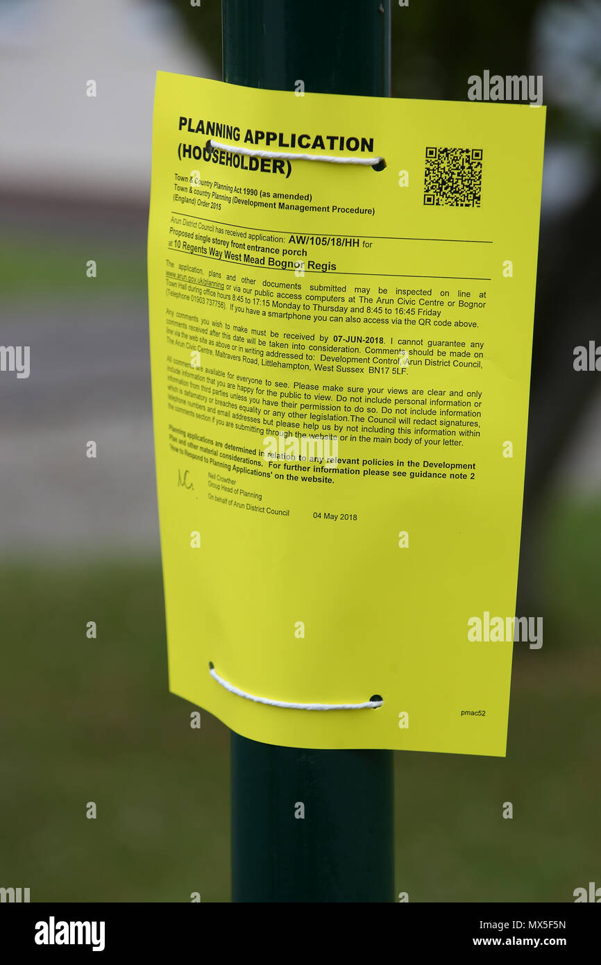 A yellow residential Planning Application notice attached to a lamppost in Bognor Regis, West Sussex, UK. - Stock Image